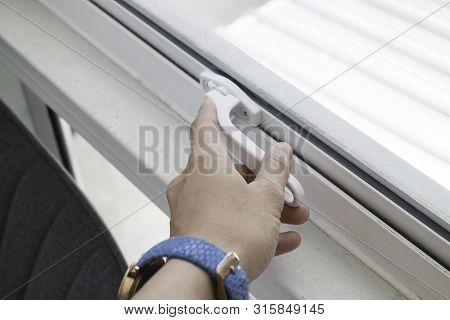 Woman Hand Opening See Through Window, Stock Photo