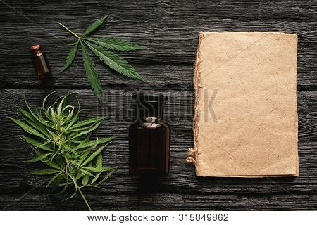 Cannabis Cbd Oil Recipe Blank Book With A Copy Space, Cbd Oil In A Bottle And Green Leaves On A Blac