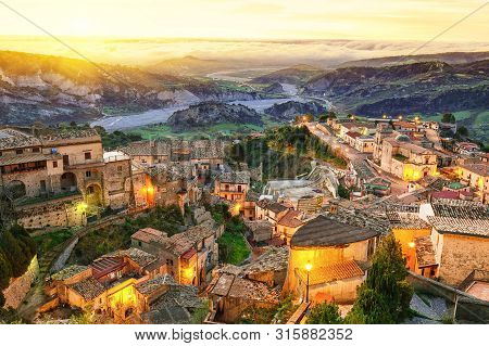 Sunrise Over Old Famous Medieval Village Stilo In Calabria. View On City And Valley. Southern Italy.