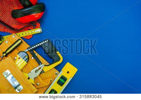 Professional tools in the bag for the joiner and spare parts.. Set for the master on blue background. poster