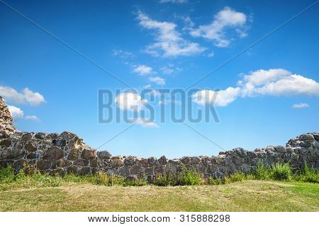 Stone Wicket On A Meadow In The Summer Under A Blue Sky In A Rural Countryside