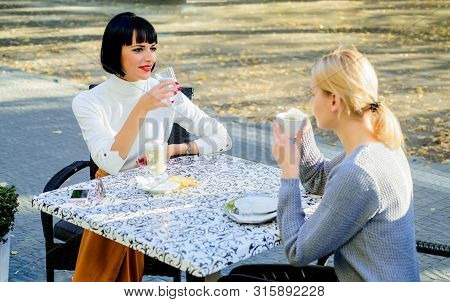 Girls Friends Drink Coffee And Talk. True Friendship Friendly Close Relations. Conversation Of Two W