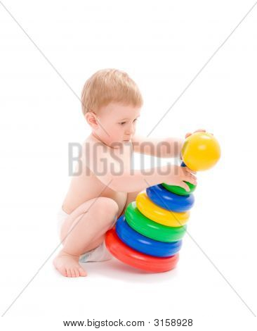 Baby Play With Tower From Colorful Discs