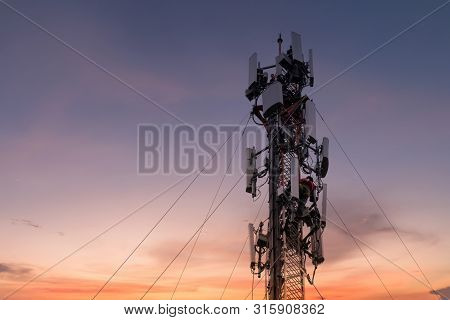 Engineer Or Technician Working On High Tower,risk Work Of High Work, People Are Working With Safety