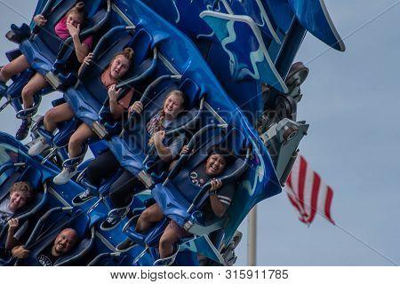 Orlando, Florida. July 26, 2019. People Screaming, Laughing And Enjoying Manta Ray Rollercoaster At