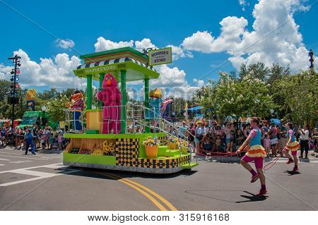 Orlando, Florida. July 30, 2019. Telly Monster And Woman Dancers  In Sesame Street Party Parade At S