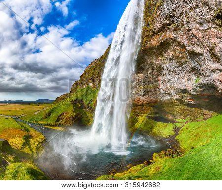 Fantastic Seljalandsfoss Waterfall In Iceland During Sunny Day. Location: Seljalandsfoss Waterfall,