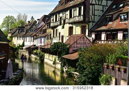 Colmar, France - April 18, 2019. Romantic Boat Trip Along The Canal In The Little Venice Of Colmar.