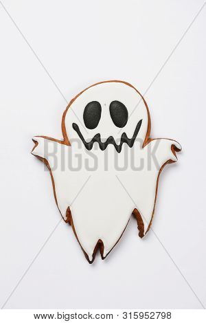 The hand-made eatable gingerbread Halloween ghost on white background poster