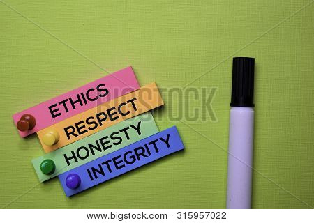 Ethics, Respect, Honesty, Integrity Text On Sticky Notes Isolated On Green Desk. Mechanism Strategy