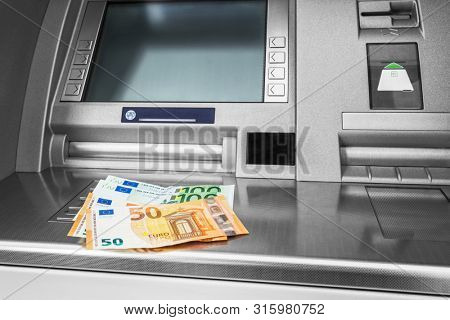 Cash withdrawal. Euro banknotes on ATM