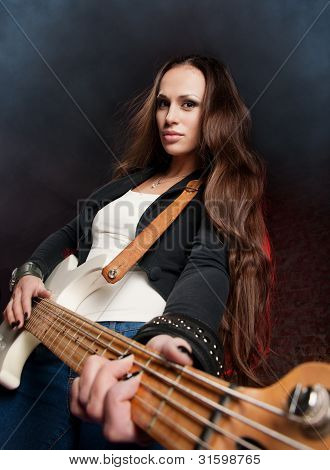 Young Beautiful Woman Playing The Guitar