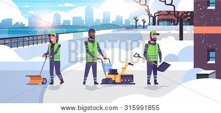 Cleaners Team Using Different Equipment And Tools Snow Removal Concept Mix Race Men Women In Uniform