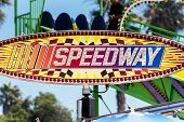 Large sign clearly advertises to potential customers where to find speedway to satisfy the adrenaline rush. poster