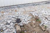 Pieces of concrete and rubble debris on construction site poster