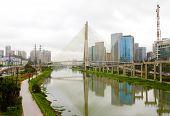 Sao Paulo city landmark Estaiada Bridge reflex in Pinheiros river, Sao Paulo, Brazil poster