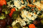 Herb baked vegetable and spinach feta strata texture background. poster