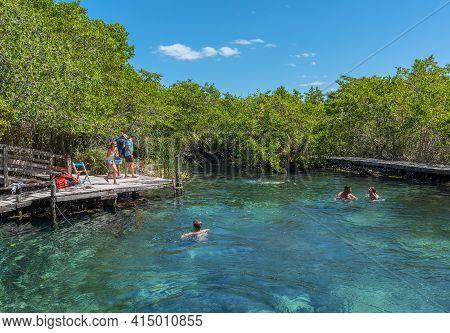 Holbox, Mexico-march 24, 2018: Tourists Swim At The Hoyo Negro Yalahau Water Hole, Isla Holbox, Mexi