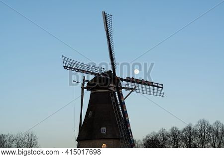 Traditional Dutch Grain Wind Mill In Oerle, North Brabant