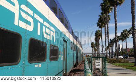 San Diego, California Usa - 13 Feb 2020: Coaster Commuter And Palms, Public Rail Transportation In A
