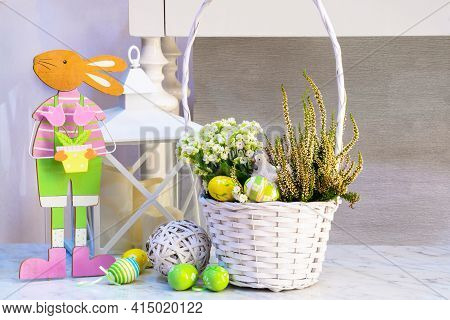 Easter Composition On A Marble Table Surface From A White Wicker Basket With Spring Flowers, Chicken