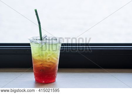 Beverage Juicy Soft Drink In Summer Concept. Freshness Mix Sweet Fruity Soda With Splash Ice In Plas