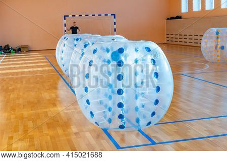 Colorful Bumper Ball Bubble Balloons In The Sports Hall. Equipment For Team Building Sport Game Name