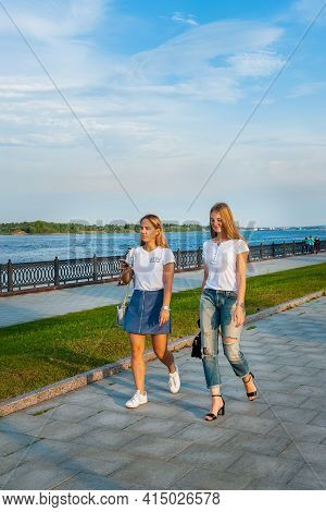 Yaroslavl, Russia-august 4, 2018: Two Young Girls Walk Along The Embankment On A Summer Day. Embankm