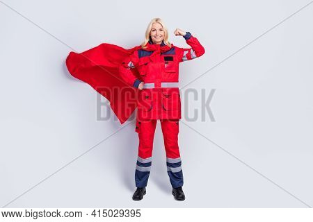 Full Length Photo Of Strong Brave Old Woman Work Hero Ambulance Wear Cape Show Muscle Isolated On Gr