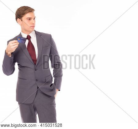 Portrait Handsome Young Business Man Holding Plastic Credit Card And Looking At Copy Space Standing