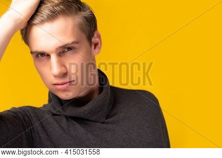 Portrait Young Handsome Caucasian Man Posing With Hand Sleek Hair Studio Shot Isolated On Yellow Bac