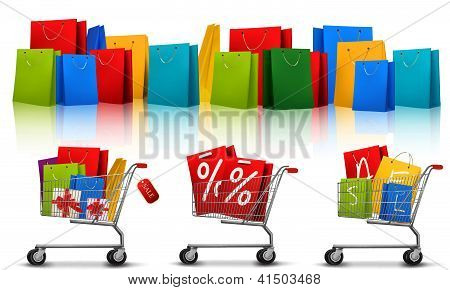 Background With Shopping Color Bags And Shopping Carts With Sale. Concept Of Discount. Vector