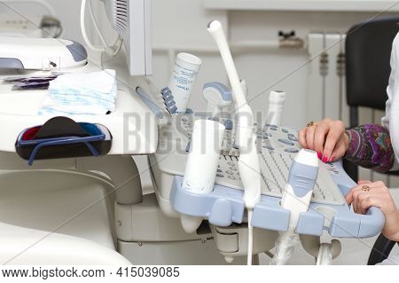 Ultrasound Machine Closeup And Doctors Hand. Medical Equipment. Medical Ultrasound Devices In The Of