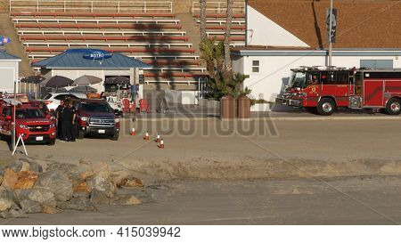 Oceanside, California Usa -11 Feb 2020: Red Fire Engine By Ocean Beach Near Los Angeles. Firefighter