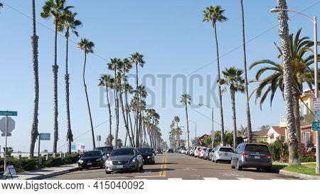 Oceanside, California Usa - 16 Feb 2020: Cars On Road And People Walking, Waterfront Promenade. Paci