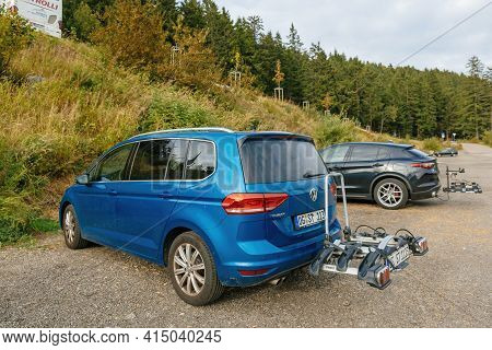 Mummelsee, Germany - Sep 22, 2018: Rear View At The Lava Blue Colored Volkswagen Touran Van With Bik