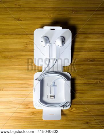Paris, France - Oct 2, 2018: View From Above At The Earpods, Wired Earbuds With Lightning Connector