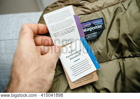 Lyon, France - Feb 16, 2021: Pov Male Hand Reading H2no Performance Standard Benchmark Tag Of New Pa