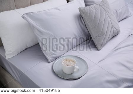 Cup Of Coffee On Bed With Soft Silky Bedclothes