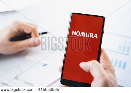 Russia Moscow 29.03.2021 Mobile Phone With Logo Of Nomura Holdings Broker.investment Finance Company