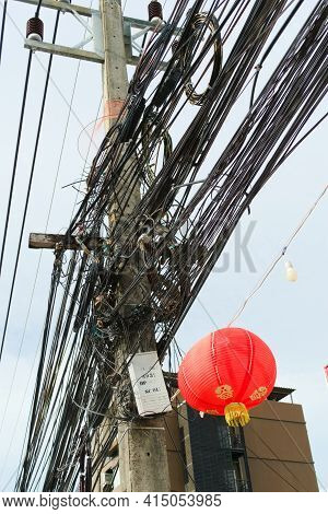 Chaotic, Messy Cables On A Pole In Phuket, Thailand.