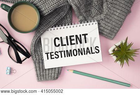 Client Testimonials Memo Written On A Notebook With Pen