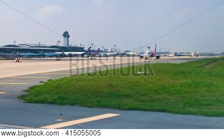2019-11-14 / Ho Chi Minh City, Vietnam - Airliners Queue Up In The Taxiway Of The Airport, Awaiting