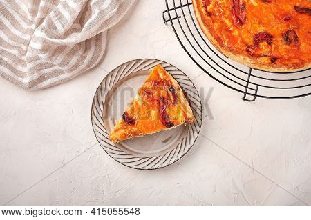 Piece Of Homemade Quiche Pie With Chicken, Dried Tomatoes, Cheddar Cheese On Ceramic Plate, Top View