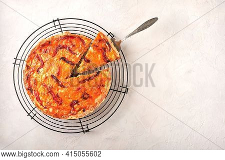 Piece Of Homemade Quiche Pie With Chicken, Dried Tomatoes, Cheddar Cheese On Shoulder Blade