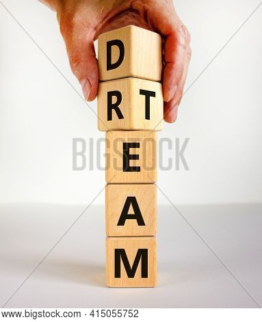Dream Team Symbol. Businessman Turns Cubes And Changes The Word 'dream' To 'team'. Beautiful White T