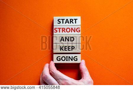Start Strong And Keep Going Symbol. Concept Words 'start Strong And Keep Going' On Wooden Blocks On