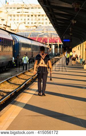 Train Crew Man Doing Checkings On The Platform At The Bucharest North Railway Station In Bucharest,