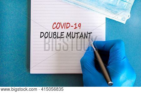 Covid-19 Double Mutant Symbol. Doctor Hand In Blue Glove With White Note. Concept Words 'covid-19 Do