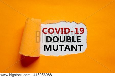 Covid-19 Double Mutant Symbol. Words 'covid-19 Double Mutant' Appearing Behind Torn Orange Paper. Me
